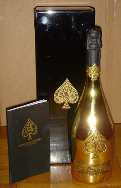 Armand de Brignac Brut Gold Ace of Spades With Box Rare New Full Sealed Mint  #ArmanddeBrignacBrutGold Armand de Brignac in the stunning gold bottle originally developed by Cattier for the André Courrèges fashion house. Cattier's gold bottle also made an appearance at Queen Elizabeth II of England's Golden Jubilee celebration. All labels for each bottle of Armand de Brignac are made of real pewter, polished and applied by hand. The quality of and the care taken with each step of its…