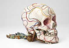 "Tetsumi Kudo. L'Ame d'Artiste d'Avant-Garde, 1986-87. Wooden support, wool, wire, fake pink eyes, 5.91 x 6.69 x 38.58"". Skull: 7 x 6 7/8 x 5""."