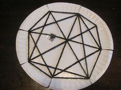Weave an Itsy Bitsy Spider web with yarn and a paper plate (Nursery Rhymes Thematic Unit)