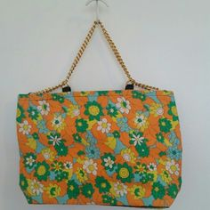 """Orange Vintage Print Floral Purse / Bag Great NWOT shoulder bag in a vintage floral pattern.   Unused condition.  Gold  chain handles.  Bottom has black piping.  Black interior with zipper pocket.  Perfect size for fitting your favorite books plus all your essentials.  Measures 15""""wide at top and 13"""" wide at bottom.  9.5"""" high.  4""""deep. Made in Japan Bags"""