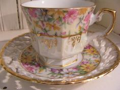 Japan lustre tea cup and Saucer with Floral Pattern.