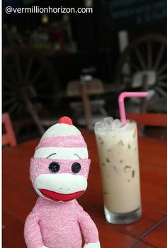 Lil' Squirt starts the day off right with Thai iced coffee (Phuket, Thailand)