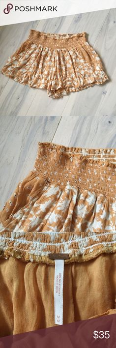 Free People crinkled gauze flutter shorts PRICE IS FIRM Crinkled rayon gauze summer festival shorts from Free People. Soft orange with a boho-style floral print. Elastic, smocked waistline, pull-on and easy to wear; super comfy. Full silhouette with lots of fabric. Size M. Free People Shorts
