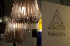 Folded origami lampshade made from metalised fabric. More origami lighting, experiments and paper lampshades can be seen at: www.foldability.co.uk