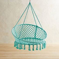 The easy-living leisure of a hammock meets the freewheeling fun of a swing in our delightful, handcrafted saucer chair. Its sturdy, wrought iron frame is dressed up with ropes that have been knotted macrame-style to form a laid-back design that can be used both indoors and out.