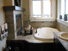This is a beautiful bathroom...I want a fireplace next to my tub too! :)  I love the tile in this bathroom.