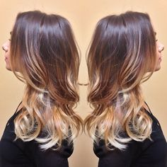 (No filter) Light warm brown base ombré'd to dark golden mid to silver ends. Haircut