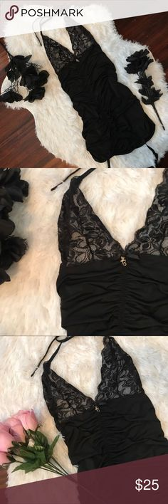 🖤 SEXY 🖤 Black stretchy lingerie dress super sexy stretchy lace top lingerie. made by dreamgirl. worn once  goes about mid thigh, just tight enough. had has garter clips on he front. tied halter top behind the neck. SUPER SEXY. pics do not do any justice.   size small/medium [has stretch]  #dreamgirl #lingerie #teddy #lace #garter #cleavage #halter #busty Intimates & Sleepwear