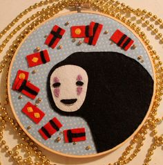 No Face Embroidery Hoop by loveandasandwich, via Flickr