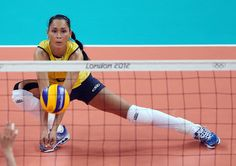 Jaqueline Carvalho #8 of Brazil passes the ball in the second set against Japan during the Women's Volleyball semifinal match on Day 13 of the London 2012 Olympics Games at Earls Court on August 9, 2012 in London, England. #Kinesiology #Tape #Taping