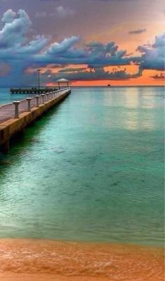 Aqua/Turquoise & Orange pier at the beach sunset by cathleen