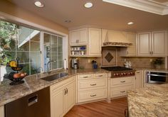 Beautiful Kitchen. Granite is Golden Beach with a travertine backsplash    www.scrivanich.com