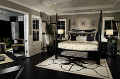 Rich bedroom with dark flooring and furniture.