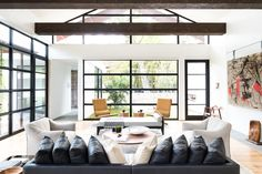 "For this project, the husband loved ultra-modern design, while the wife leaned towards a more traditional aesthetic. How to please both? ""Through the design process, we learned that their tastes were actually more closely aligned when we focused on the desired 'feel' of the home versus specific design details,"" Field says.  He and his colleagues balanced rustic, exposed ceiling beams with elegant venetian plaster walls, and artful aluminum storefront windows with functional white oak plank…"