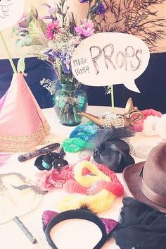 Photo Booth Props - Pile a whole bunch with wigs...hats whatever youve got at home on a small table. ,