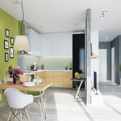 Dom prywatny w Krakowie: kuchnia z jadalnią połączona z salonem, zielone ściany, galeria na ścianie, białe krzesła, a wszystko to oddzielone cienką ścianką działową.