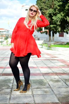 Black pantyhose with short red lace dress, leopard print high heeled shoes and heart shaped sunglasses