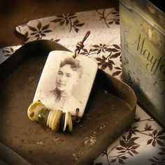 I could display Grandma's photo with some of her sewing notions, perhaps - - - Photo pendant
