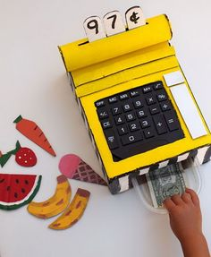 DIY Cardboard Cash Register. Does your child enjoy going to the grocery store and watching the cashier scan items? Then this cardboard cash register craft is right up your alley. A great project for kids which involves painting and building movable, interactive components. http://hative.com/fun-pretend-play-ideas-for-kids/