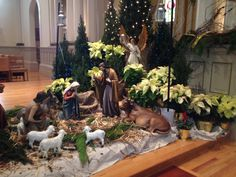 In front of altar table or on side table by tree, use small pallets for backdrop, white poinsettias Christmas Eve Mass, Christmas Manger, Christmas Nativity Scene, Christmas Scenes, Christmas Art, All Things Christmas, Christmas Parties, Christmas 2017, Church Altar Decorations
