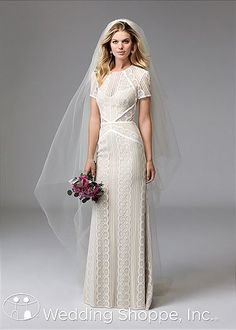 In a vintage-inspired silhouette with fresh details, the Wtoo Lenora wedding dress is ideal for the modern bride that wants to exude timeless sophistication. Beautifully crafted from lace in a circle pattern that adds an unexpected touch of texture, this sheath gown features a short sleeve silhouette with a high scoop neckline, a cut out back.