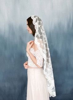 A gorgeous mantilla veil in heavy embellished beaded fabric. The edge is embellished with high quality Alencon lace. A heirloom piece to cherish that can be handed over to generations. Contact me to receive a swatch for comparison. Different lengths available to choose from scroll down menu. Picture shows fingertip length. Length of veils: Elbow-30 fingertip- 45 waltz-58 chapel-90 cathedral-120 You may purchase the closest length you require from scroll down menu. Custom lengths are…