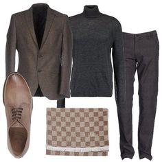 I pantaloni grigi hanno una linea classica con una fantasia a quadri tono su tono. Li abbiniamo al maglione grigio a collo alto dalla linea aderente. Aggiungiamo una giacca marrone con chiusura a due bottoni. Ai piedi scarpe marroni stringate con la punta tonda. Per finire sciarpa a scacchi beige e marrone.