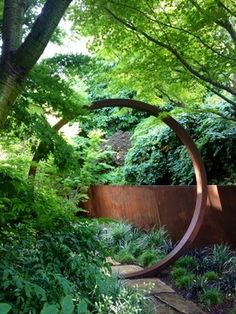A moon gate and canted retaining wall are fashioned from Cor-Ten in this garden by Davis Dalbok of Living Green and Tim O'Shea of Greenworks Gardens. Cor-Ten, a variant of steel, is becoming increasingly popular in residential landscape design.