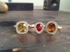 Three beautiful rings, each with the power to capture light and make it dance. which is your pick? Gems Jewelry, Diamond Jewelry, Fine Jewelry, Jewelry Branding, Beautiful Rings, Handcrafted Jewelry, Color Pop, Gemstone Rings, Bling