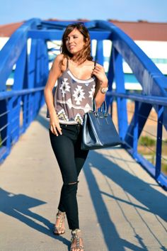 A pretty sheer top pairedd with simple accessories and pretty bralette.