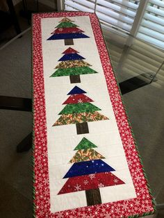 This quilted Christmas table runner measures 16 1 2 Quilted Table Runners Christmas, Patchwork Table Runner, Christmas Patchwork, Christmas Runner, Table Runner And Placemats, Table Runner Pattern, Christmas Sewing, Christmas Projects, Christmas Decorations