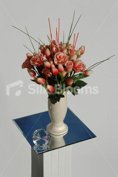 Peach artificial tulip and rose vase table display, ideal for your home. Real touch flowers. Artificial floral arrangement for your home. Luxury peach rose and tulip table display, amazing quality. Comes assembled in a cream ceramic vase, ready to sit in place. Homewear decoration perfect for tables and mantelpieces. Artificial vase display measures approximately 40cm tall; 25cm wide. Flowers can be changed to any desired colour or species.