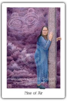 "Gaian Tarot Nine of Air (swords) ""A woman is grieving, on a much deeper soul level than the distress of the 3 of Air. Storm clouds billow behind her, mirroring her inner turmoil. Yet she has gone to a sacred spot, and embraces a standing stone as if it were her mother. She goes deep into a trance state, letting her sorrow ground into the body of the earth. And with her inner vision she sees the face of She Who Watches — the One who always watches over her with love and compassion. (Note: She…"