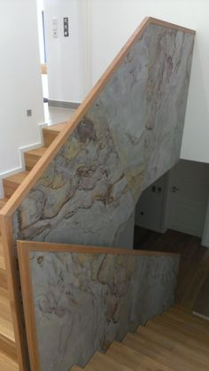 Slate veneer tile used to as wall covering at staircase.