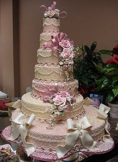 Flowers and lacey icing make for an elegant wedding cake.