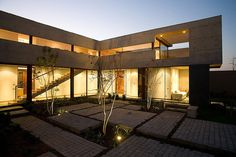 courtyard-house-with-glass-lower-floor-and-concrete-upper-12.jpg