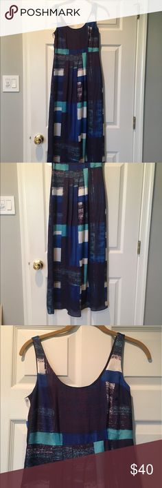 Ann Taylor Maxi Dress - Blue tones New without tags. Never been worn. Lined. Silky like material. Can be dressed up or down! Perfect for spring/summer casual weddings. Zips on side. Ann Taylor Dresses Maxi