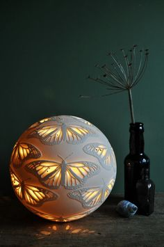 Came across this gorgeous Monarchs Porcelain Lamp by Amy Cooper Ceramics on Etsy, Lots of other designs, too, including peacock feathers. Ceramic Clay, Ceramic Pottery, Ceramic Lamps, Ceramic Lantern, Sculptures Céramiques, Ceramic Light, Paperclay, Clay Art, Chandeliers
