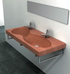 Often thought of the most suitable hardwood for outdoor furnishings because of its hardiness when exposed to water, heat and humidity, teak makes for great bathroom tubs and sink basins as well. Bathroom Sink Design, Bathroom Basin, Bathroom Fixtures, Wooden Vanity, Wooden Bathroom, Wood Sink, Teak Wood, Cool Furniture, Timber Furniture