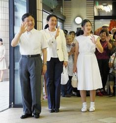 (L to R) Crown Prince Naruhito, Crown Princess Masako and their daughter Princess Aiko wave to well-wishers upon arrival at Izukyu Shimoda Station on 12 August 2014 in Shimoda, Shizuoka, Japan