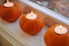 Pumpkin themed Halloween Candles with a little tea light inside.
