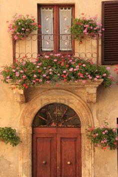 outdoor balcony Flowers on an European balcony Balcony Flowers, Window Box Flowers, Window Boxes, Fachada Colonial, Balcony Lighting, Outdoor Balcony, Balcony Gardening, Old Doors, Entrance Doors