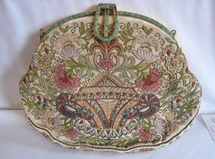 Art Deco evening purse with exquisite tambour embroidery.The frame is set with green baguette shaped Czechoslovakian glass stones.