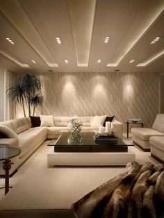 Cozy and classy basement with recessed lighting and lamps to make basement look like it has more light.