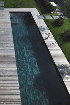lap pool with great drama, black bottom pool, teak decking/coping