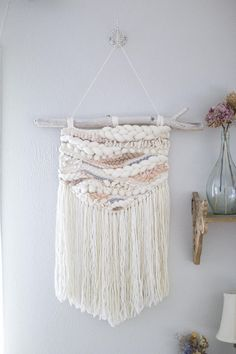 **This is made to order, please check the shop announcement for current processing/shipping times. Each weave is unique, no two are the same. The above images are representative of what you will receive.** Beautiful natural whites woven with rich texture accented with peach, champagne, grey, and pale pinks. Dupioni silk adds a touch of shimmer. This would be a beautiful addition to a nursery, wall gallery, or a stand alone statement piece. Woven area measures approximately 15 x 30 (han...