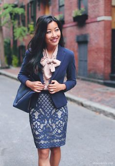 business formal office outfit idea - blazer, blow blouse, and lace skirt. navy and neutral color scheme