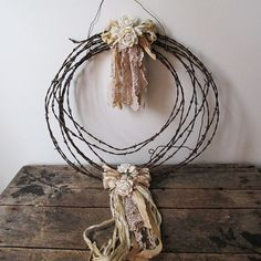 Rusty farmhouse wreath barbed wire metal wall hanging country cottage white roses and tattered ribbon home decor anita spero design