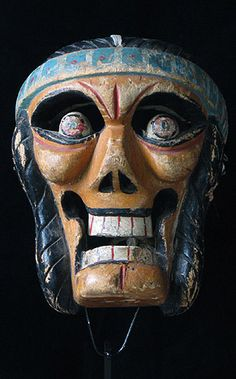 """Mexican Indian mask  Veracruz, Mexico    10 inches, painted wood    Carved by Lino Mora, it is one of several of """"dark forces"""" characters that are commanded in the dance by a very large Pilate. Other dark forces include a devil, skull, pirate, moor, etc."""