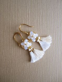 A personal favorite from my Etsy shop https://www.etsy.com/ca/listing/455079288/bridal-tassel-earrings-with-swarovski